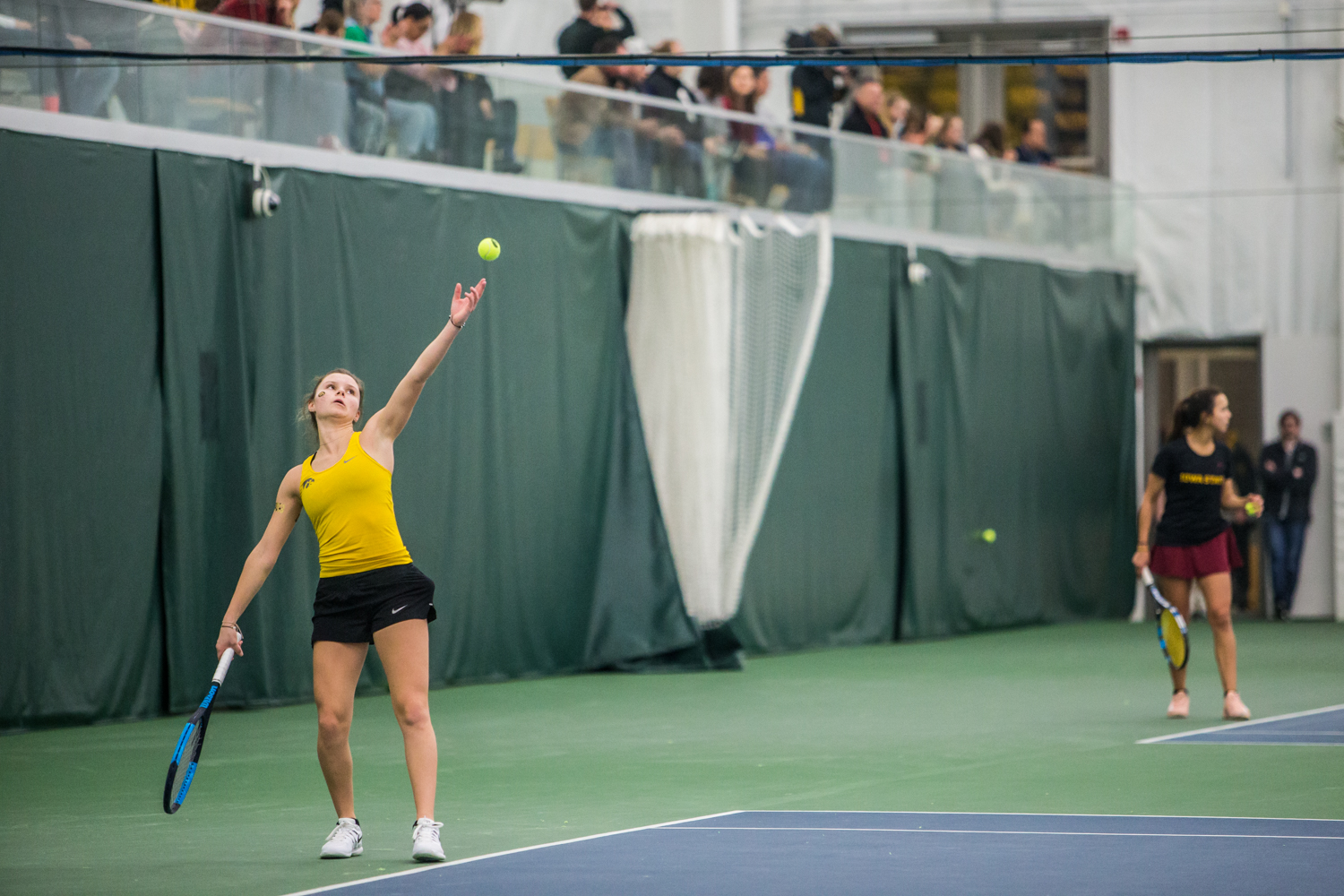 Iowa%27s+Cloe+Ruette+serves+during+a+women%27s+tennis+matchup+between+Iowa+and+Iowa+State+at+the+Hawkeye+Tennis+and+Recreation+Complex+on+Friday%2C+February+8%2C+2019.++The+Hawkeyes+dropped+the+doubles+point+but+swept+singles+matches%2C+defeating+the+Cyclones+4-1.