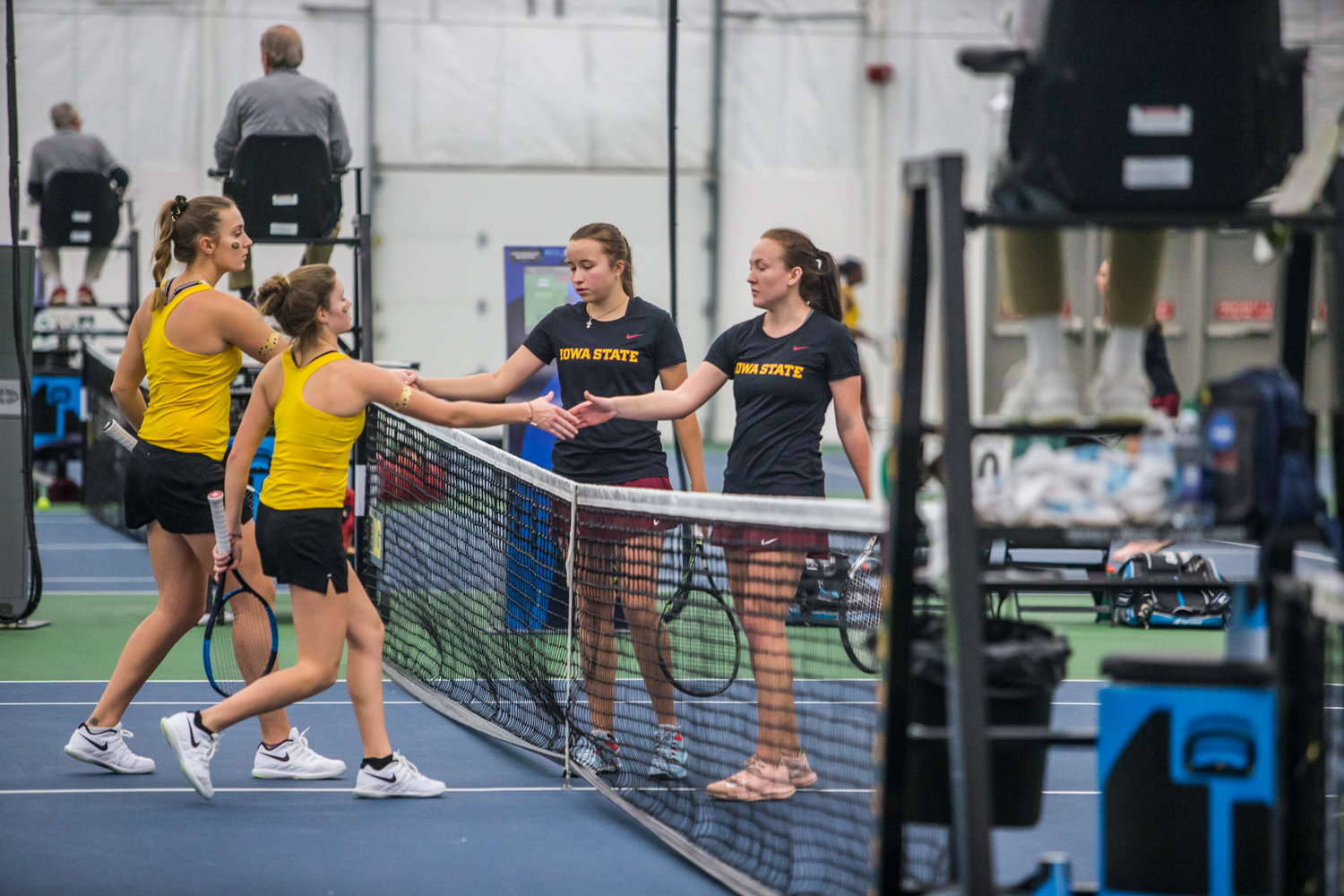 Iowa%27s+Cloe+Ruette+and+Ashleigh+Jacobs+shake+hands+with+Iowa+State%27s+Ekaterina+Grib+and+Margarita+Timakova+during+a+women%27s+tennis+matchup+between+Iowa+and+Iowa+State+at+the+Hawkeye+Tennis+and+Recreation+Complex+on+Friday%2C+February+8%2C+2019.++The+Hawkeyes+dropped+the+doubles+point+but+swept+singles+matches%2C+defeating+the+Cyclones+4-1.