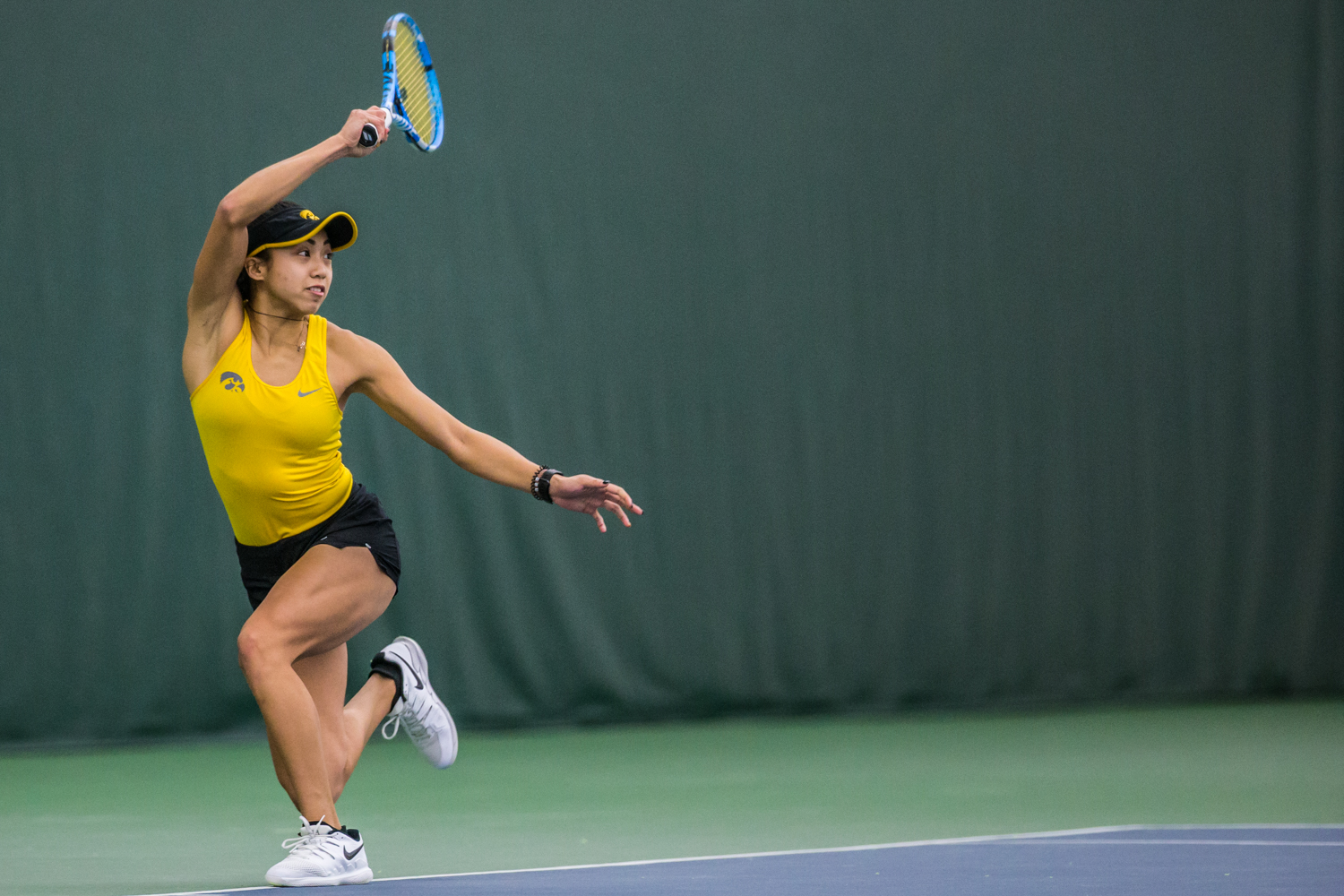 Iowa%27s+Michelle+Bacalla+hits+a+forehand+during+a+women%27s+tennis+matchup+between+Iowa+and+Iowa+State+at+the+Hawkeye+Tennis+and+Recreation+Complex+on+Friday%2C+February+8%2C+2019.++The+Hawkeyes+dropped+the+doubles+point+but+swept+singles+matches%2C+defeating+the+Cyclones+4-1.