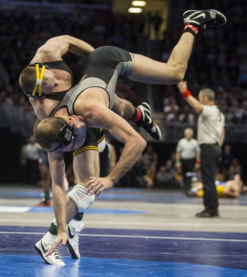 Iowa's 165-pound Alex Marinelli takes down Purdue's Jacob Morrissey during Session 1 of the NCAA Division 1 Wrestling Championships at Quicken Loans Arena in Cleveland, Ohio on Thursday, March 15, 2018. Marinelli went on to defeat Morrissey by fall in 6:20. Iowa leads the tournament with 18.5 team points at the end of Session 1.