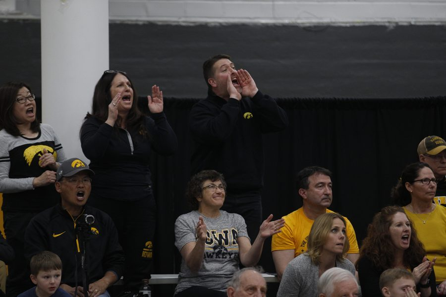 Hawkeye fans do the IOWA cheer with the team during the meet against Nebraska at the UI Field House on Saturday, March 2, 2019. Iowa took the victory with a score of 406.500 over Nebraska with a score of 403.550.