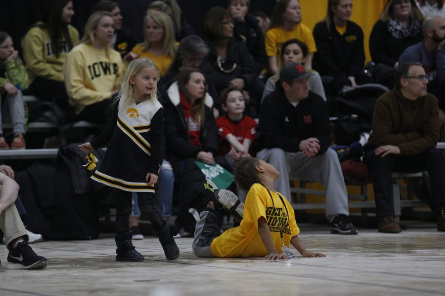 Two young fans imitate a floor routine during the meet against Nebraska at the UI Field House on Saturday, March 2, 2019.