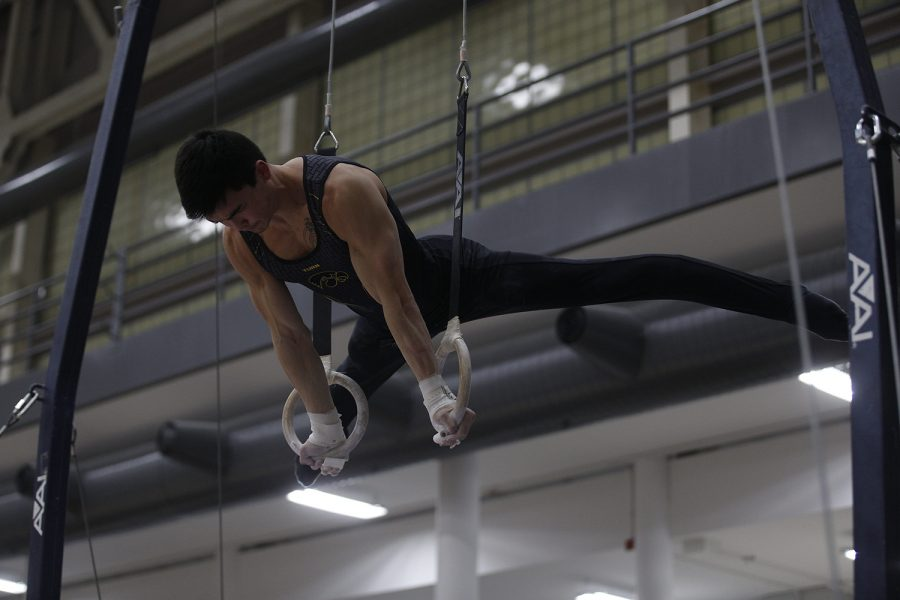 Brandon Wong competes on the rings during the meet against Nebraska at the UI Field House on Saturday, March 2, 2019. Brandon took home a career best with a 13.900 on this event to place second. Iowa took the victory with a score of 406.500 over Nebraska with a score of 403.550.