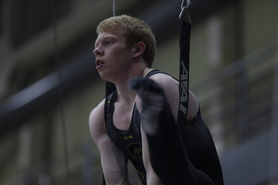 Nick Merryman competes on the rings during the meet against Nebraska at the UI Field House on Saturday, March 2, 2019. Iowa took the victory with a score of 406.500 over Nebraska with a score of 403.550.