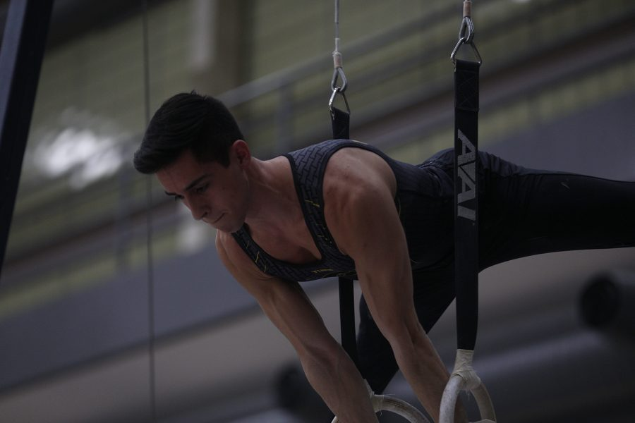 Andrew Herrador competes on the rings against Nebraska at the UI Field House on Saturday, March 2, 2019. Iowa took the victory with a score of 406.500 over Nebraska with a score of 403.550.