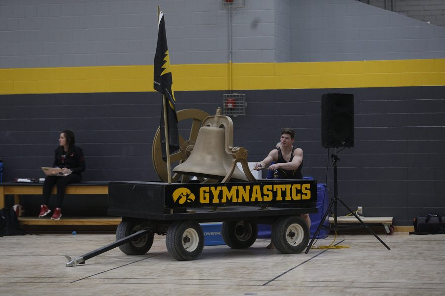Stewart Brown rings the bell after sticking a perfect landing on vault during the meet against Nebraska at the UI Field House on Saturday, March 2, 2019. He took home a career best with a 14.250. Iowa took the victory with a score of 406.500 over Nebraska with a score of 403.550.