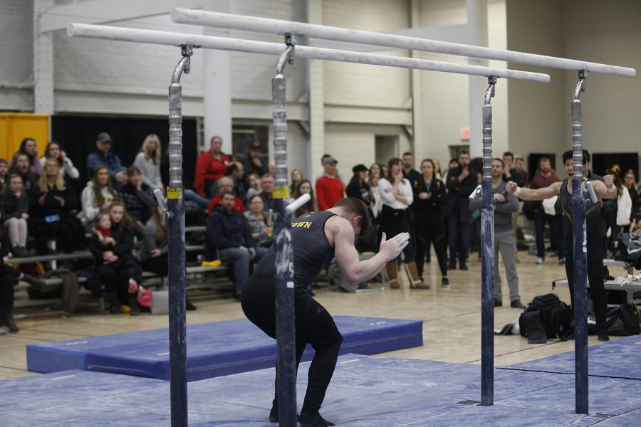 Stewart Brown celebrates a successful stuck landing during the meet against Nebraska at the UI Field House on Saturday, March 2, 2019. Iowa took the victory with a score of 406.500 over Nebraska with a score of 403.550.