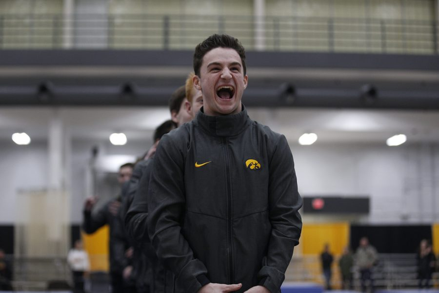 Jake Brodarzon celebrates as he accepts his award during the meet ceremony after the meet against Nebraska at the UI Field House on Saturday, March 2, 2019.  Iowa took the victory over Nebraska 406.700 to 403.550.