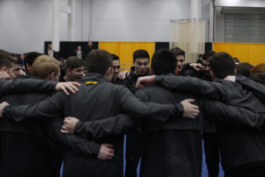 After the meet, the team gathers one final time for congratulations and celebration against Nebraska at the UI Field House on Saturday, March 2, 2019.  Iowa took the victory over Nebraska 406.700 to 403.550.