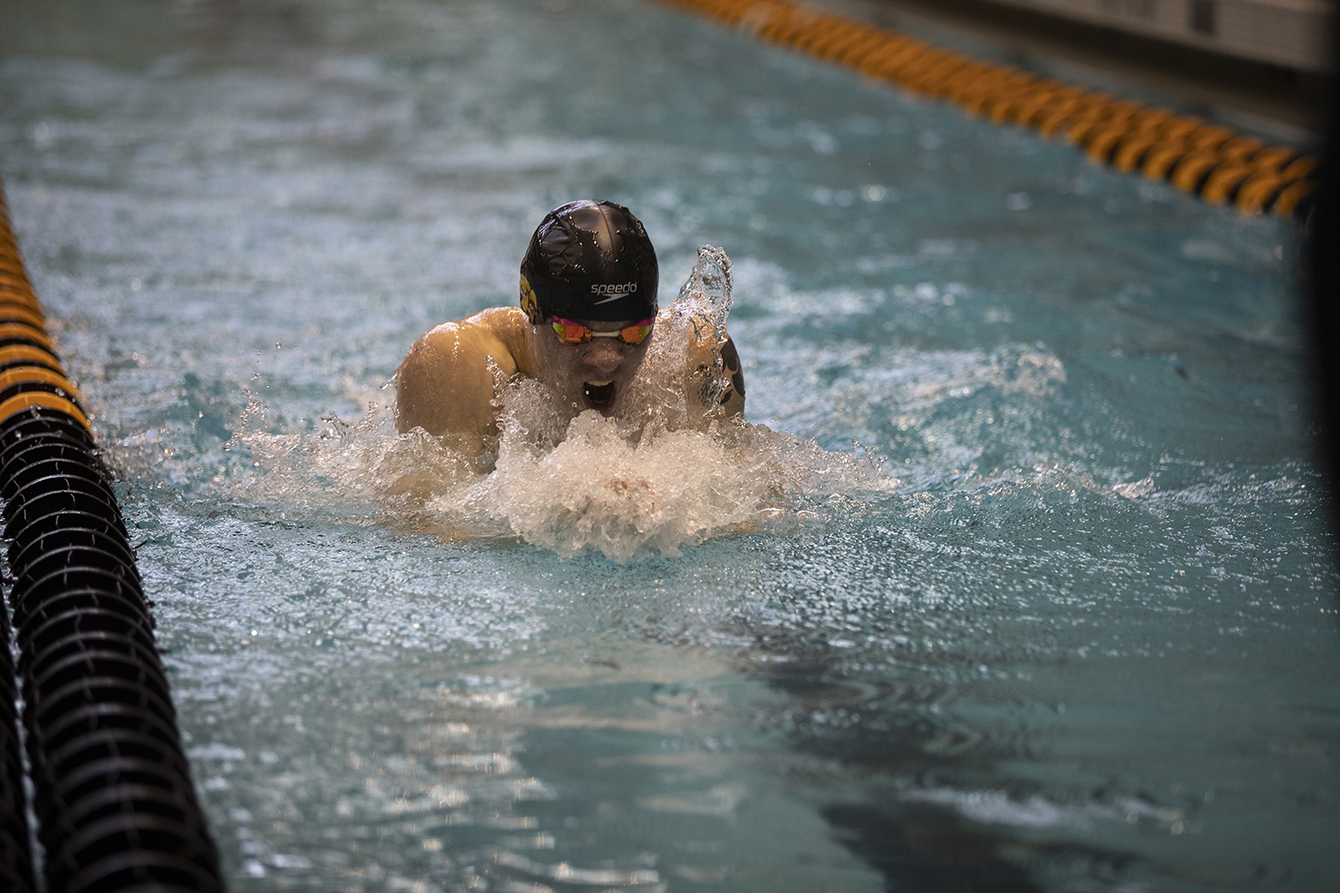 Iowa+senior+Tanner+Nelson+swims+the+100+breast+stroke+during+preliminary+competition+of+the+Big+10+Swimming+Championships+on+Friday%2C+March+1%2C+2019.+