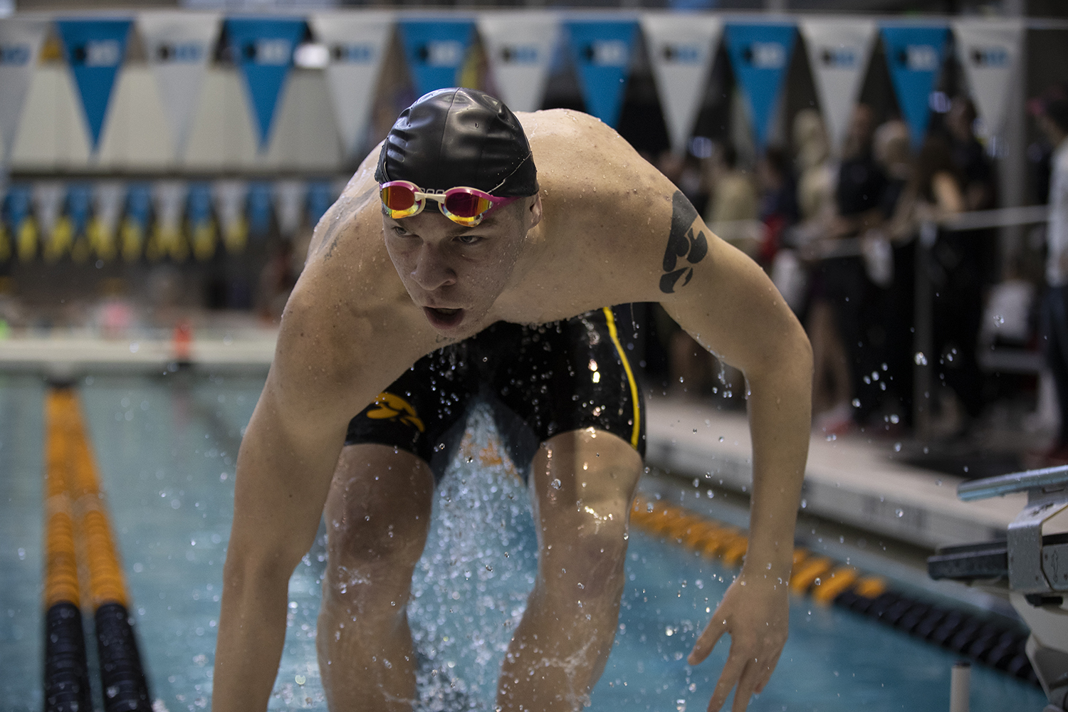 Tanner+Nelson+gets+out+of+the+pool+after+swimming+the+100+breast+stroke+during+preliminary+competition+of+the+Big+10+Swimming+Championships+on+Friday%2C+March+1%2C+2019.+