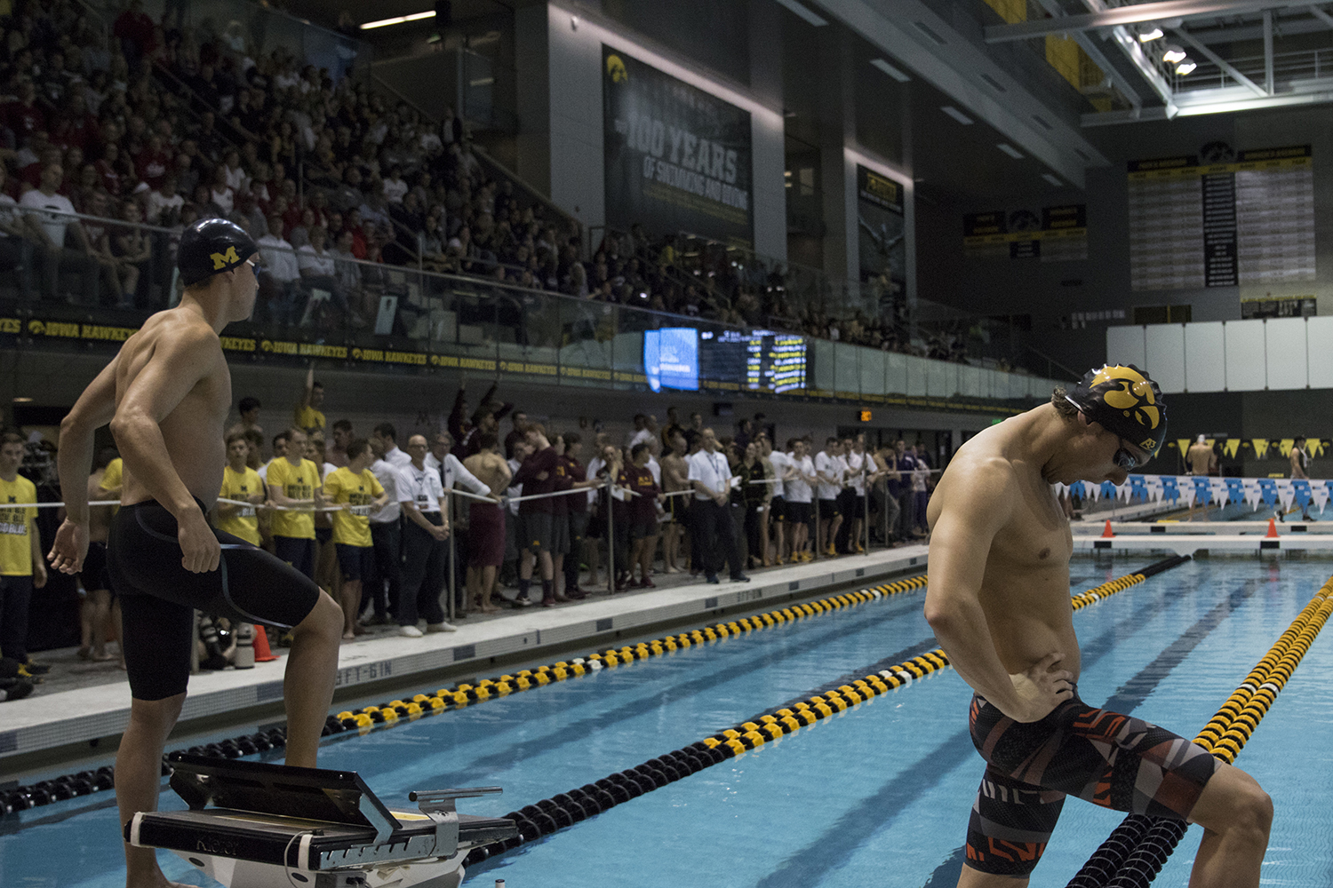 Dani+Swanepoel+from+the+University+of+Iowa+and+William+Chan+from+the+University+of+Michigan+step+up+to+the+starting+blocks+for+the+Men%27s+200+yard+breaststroke+consolation+finals+during+the+final+day+of+the+2019+Big+Ten+Men%27s+Swimming+and+Diving+Championships+at+the+CRWC+on+March+2%2C+2019.+Swanepoel+placed+fourth+with+a+time+of+1%3A55%3A51%2C+while+Chan+placed+eighth+with+a+time+of+2%3A00%3A04.+