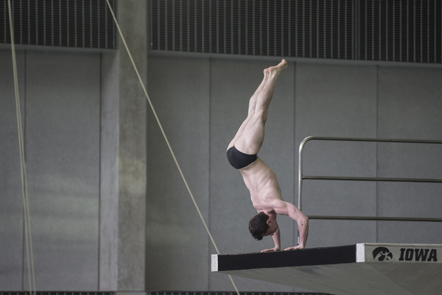 Indiana%27s+Mory+Gould+sets+up+for+a+handstand+dive%2C+which+earned+him+a+score+of+43.2+during+preliminary+rounds+of+the+men%27s+Big+10+Swimming+Championships+on+Saturday%2C+March+3%2C+2019.