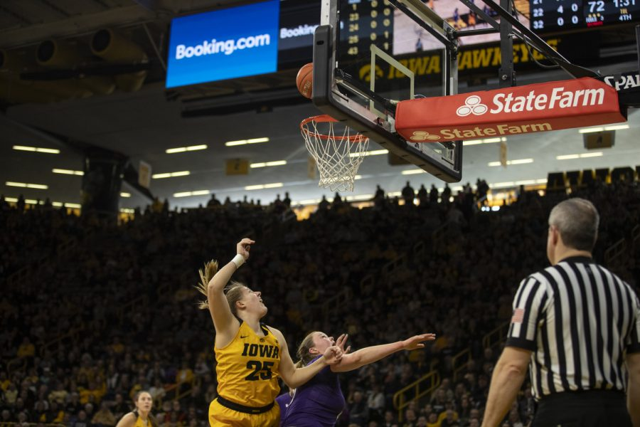 Monika Czinano, forward and center, (25) goes for a lay-up during women's basketball against Northwestern in Carver-Hawkeye Arena on March 3, 2019. Iowa defeated Northwestern 74-50.