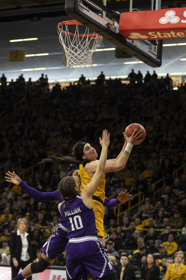 Forward Megan Gustafson goes for a lay-up during women's basketball against Northwestern in Carver-Hawkeye Arena on March 3, 2019. Iowa defeated Northwestern 74-50.