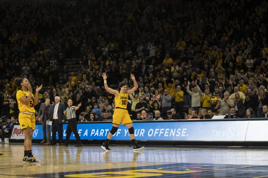 Megan+Gustafson+walks+off+the+Carver+court+for+the+last+time+during+women%27s+basketball+against+Northwestern+in+Carver-Hawkeye+Arena+on+March+3%2C+2019.+Iowa+defeated+Northwestern+74-50.+