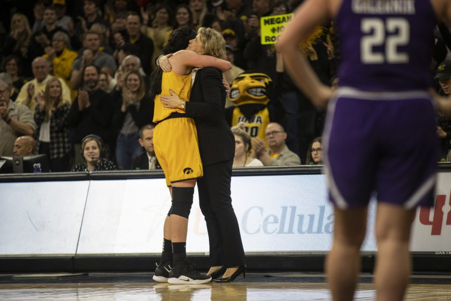 Megan Gustafson hugs Head Coach Lisa Bluder after being called off the Carver court for the last time during women's basketball against Northwestern in Carver-Hawkeye Arena on March 3, 2019. Iowa defeated Northwestern 74-50.