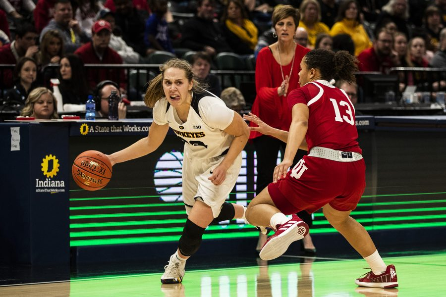 Iowa guard Kathleen Doyle dribbles past Indiana guard Jaelynn Penn during the women's Big Ten tournament basketball game vs. Indiana at Bankers Life Fieldhouse on Friday, March 8, 2019. The Hawkeyes defeated the Hoosiers 70-61.