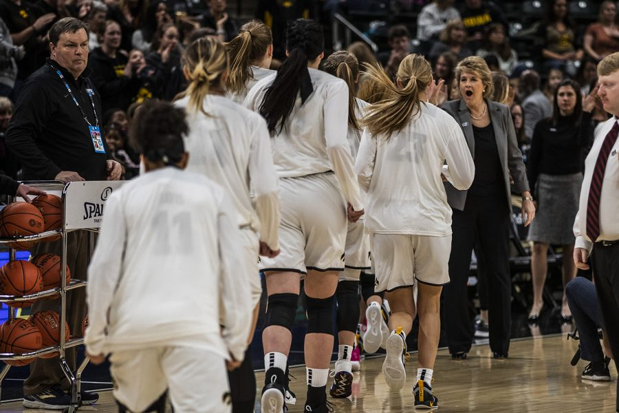 Iowa head coach Lisa Bluder cheers on the Iowa players during the women's Big Ten tournament basketball game vs. Indiana at Bankers Life Fieldhouse on Friday, March 8, 2019. The Hawkeyes defeated the Hoosiers 70-61.