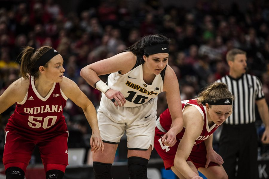 From left: Indiana forward Brenna Wise, Iowa center Megan Gustafson, and Indiana guard Grace Berger wait to attempt a rebound during the women's Big Ten tournament basketball game vs. Indiana at Bankers Life Fieldhouse on Friday, March 8, 2019. The Hawkeyes defeated the Hoosiers 70-61.