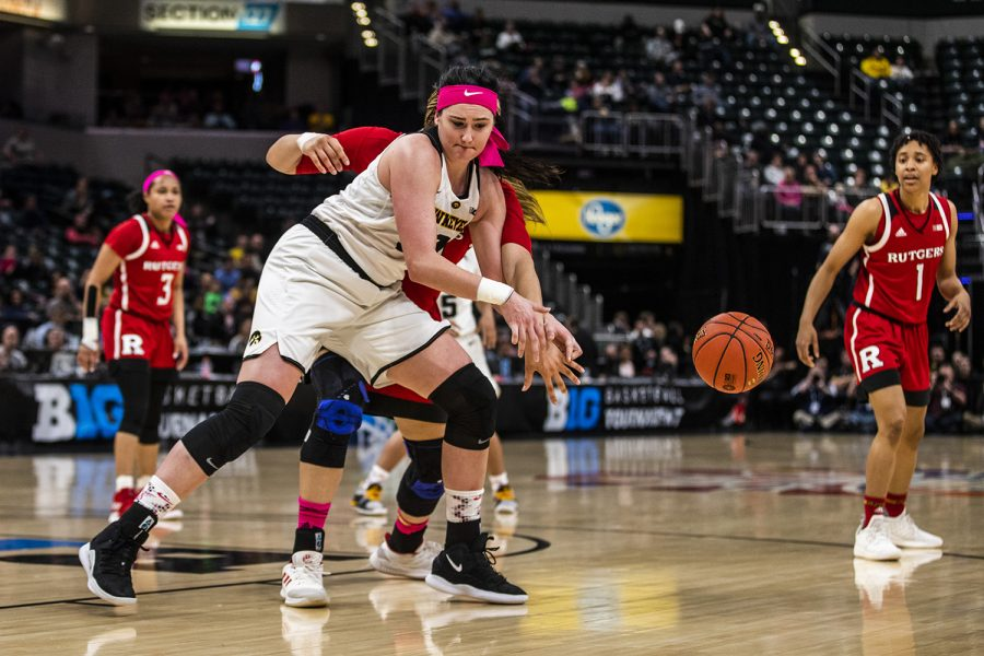 Iowa center Megan Gustafson fights for the ball during the women's Big Ten tournament basketball game vs. Rutgers at Bankers Life Fieldhouse on Saturday, March 9, 2019. The Hawkeyes defeated the Scarlet Knights 72-67 and will be moving on to the championship game against Maryland. (Katina Zentz/The Daily Iowan)