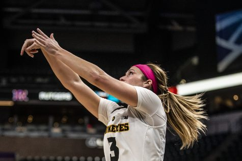 Iowa guard Mackenzie Meyer shoots the ball during the women's Big Ten tournament basketball game vs. Rutgers at Bankers Life Fieldhouse on Saturday, March 9, 2019. The Hawkeyes defeated the Scarlet Knights 72-67 and will be moving on to the championship game against Maryland.