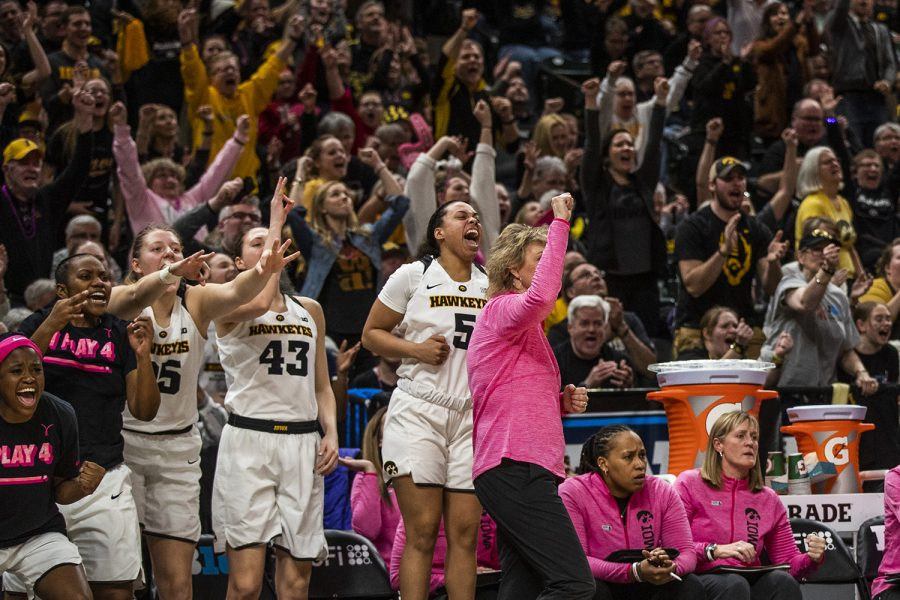 Iowa players and fans cheer during the women's Big Ten tournament basketball game vs. Rutgers at Bankers Life Fieldhouse on Saturday, March 9, 2019. The Hawkeyes defeated the Scarlet Knights 72-67 and will be moving on to the championship game against Maryland.