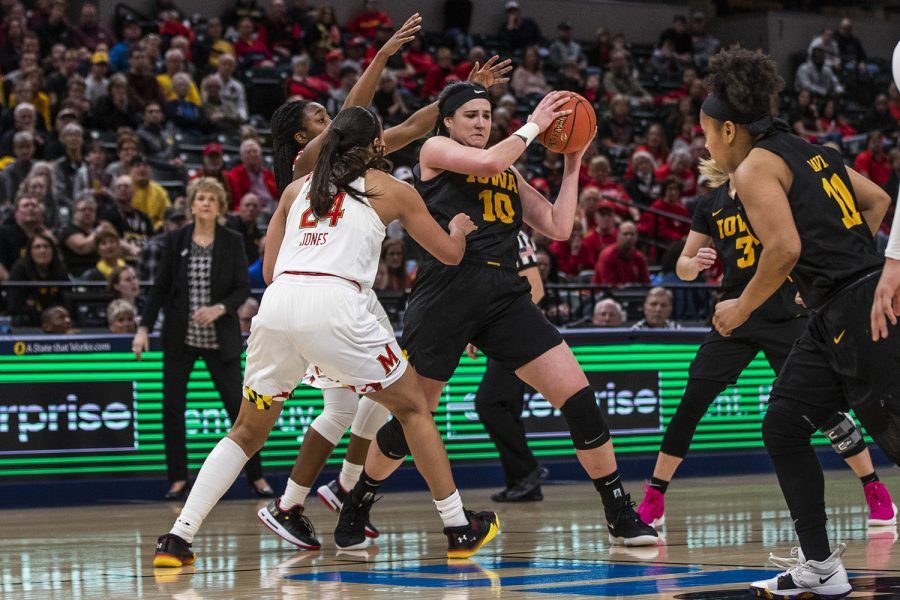 Iowa+center+Megan+Gustafson+keeps+the+ball+away+from+Maryland+players+during+the+women%27s+Big+Ten+Championship+basketball+game+vs.+Maryland+at+Bankers+Life+Fieldhouse+on+Sunday%2C+March+10%2C+2019.+The+Hawkeyes+defeated+the+Terrapins+90-76+and+are+the+Big+Ten+champions.