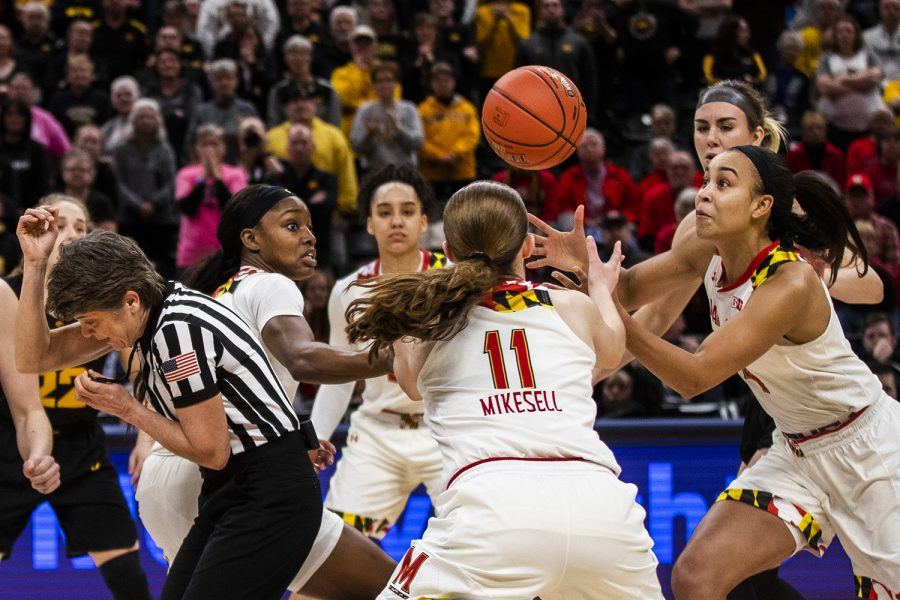 Maryland+players+reach+for+the+ball+after+tip-off+during+the+women%27s+Big+Ten+Championship+basketball+game+vs.+Maryland+at+Bankers+Life+Fieldhouse+on+Sunday%2C+March+10%2C+2019.+The+Hawkeyes+defeated+the+Terrapins+90-76+and+are+the+Big+Ten+champions.