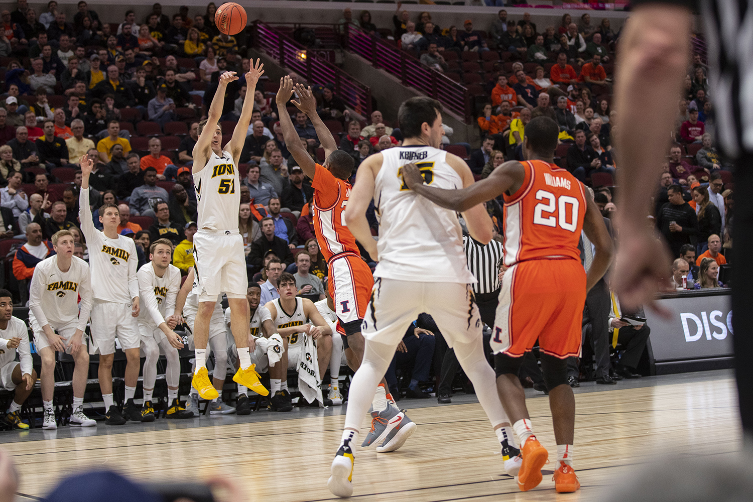 Iowa forward Nicholas Baer (51) attempts a 3-pointer during the Iowa/Illinois Big Ten Tournament men's basketball game in the United Center in Chicago on Thursday, March 14, 2019. (Lily Smith/The Daily Iowan)