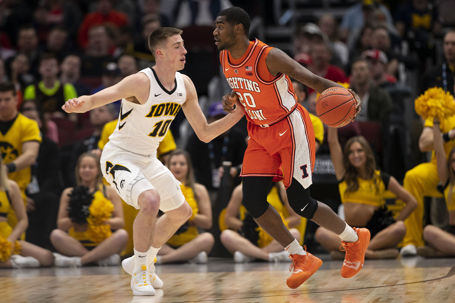 Iowa's Joe Wieskamp guards Illinois' Da'Monte Williams during the Iowa/Illinois Big Ten Tournament men's basketball game in the United Center in Chicago on Thursday, March 14, 2019. The Hawkeyes defeated the Fighting Illini, 83-62.
