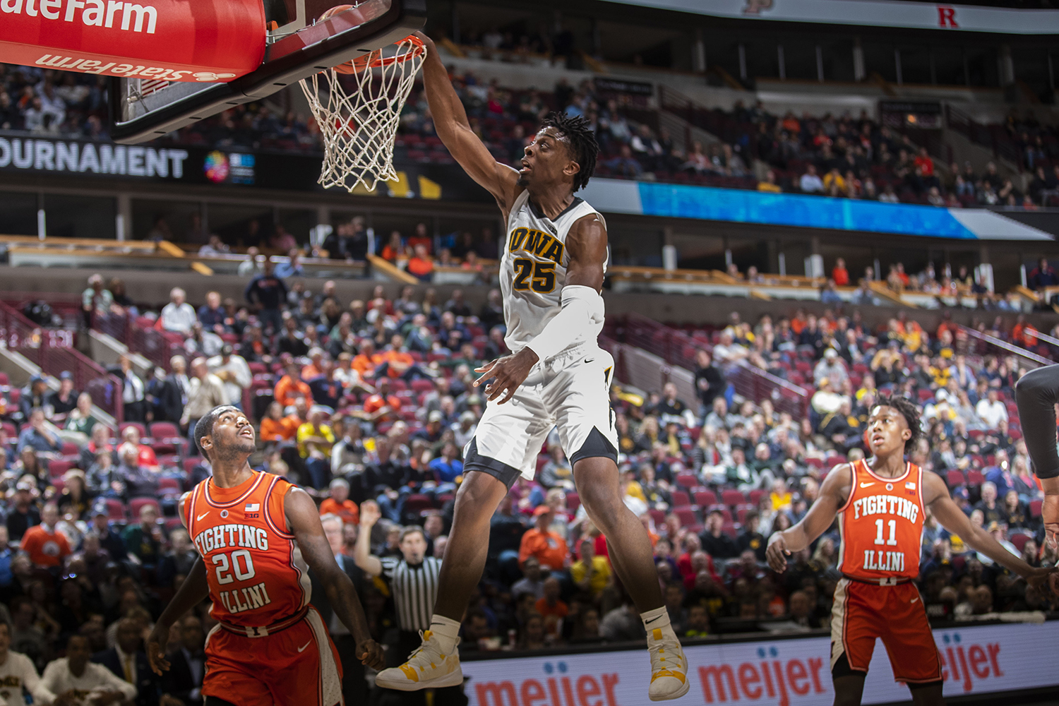 Iowa forward Tyler Cook dunks during the Iowa/Illinois Big Ten Tournament men's basketball game in the United Center in Chicago on Thursday, March 14, 2019. The Hawkeyes defeated the Fighting Illini, 83-62.