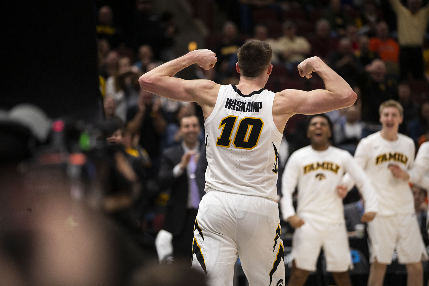 Iowa forward Joe Wieskamp flexes after dunking during the Iowa/Illinois Big Ten Tournament men's basketball game in the United Center in Chicago on Thursday, March 14, 2019. The Hawkeyes defeated the Fighting Illini, 83-62.