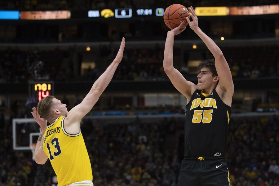Iowa+forward+Luka+Garza+attempts+a+shot+over+Michigan+forward+Ignas+Bradzeikis+during+the+Iowa%2FMichigan+Big+Ten+Tournament+men%27s+basketball+game+in+the+United+Center+in+Chicago+on+Friday%2C+March+15%2C+2019.+The+Wolverines+lead+the+Hawkeyes%2C+40-27%2C+at+the+half.+
