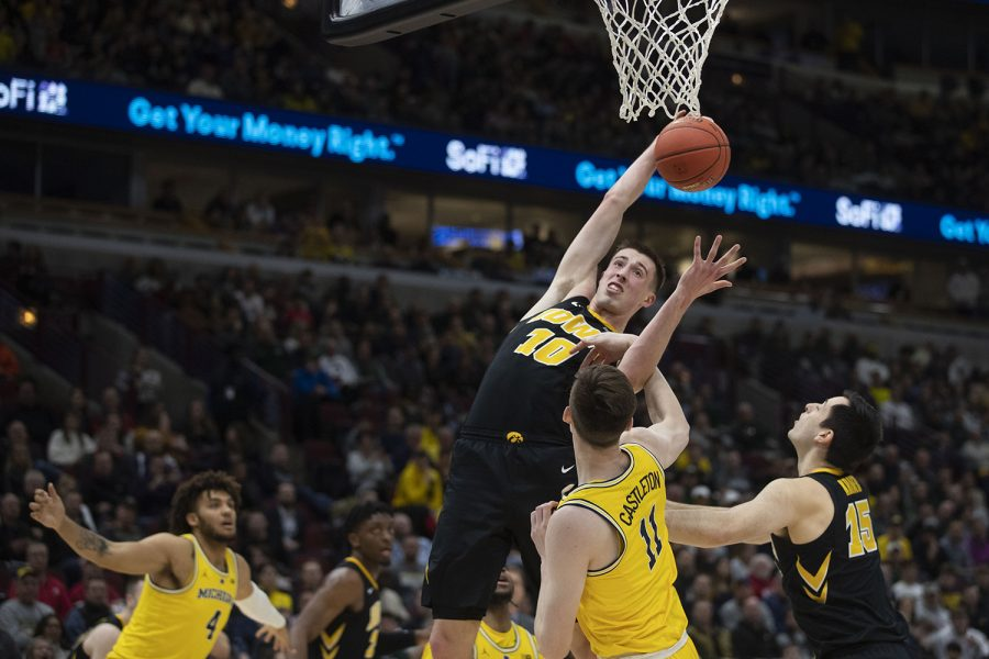 Iowa+guard+Joe+Wieskamp+grabs+a+rebound+during+the+Iowa%2FMichigan+Big+Ten+Tournament+men%27s+basketball+game+in+the+United+Center+in+Chicago+on+Friday%2C+March+15%2C+2019.+The+Wolverines+lead+the+Hawkeyes%2C+40-27%2C+at+the+half.+