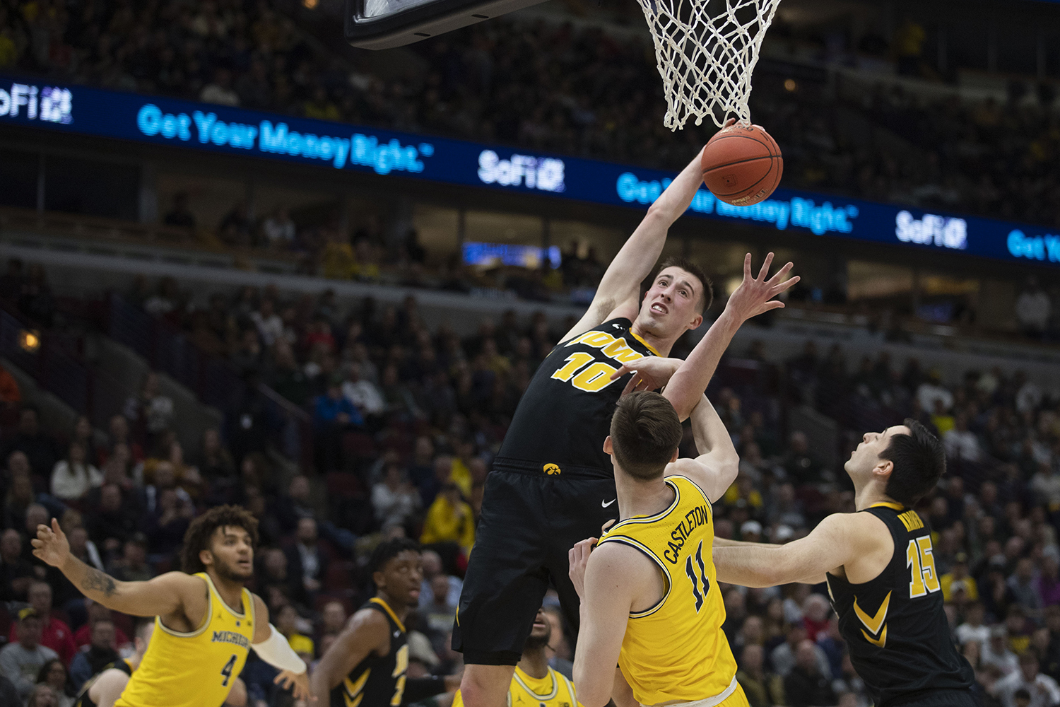 Iowa guard Joe Wieskamp grabs a rebound during the Iowa/Michigan Big Ten Tournament men's basketball game in the United Center in Chicago on Friday, March 15, 2019. The Wolverines lead the Hawkeyes, 40-27, at the half.