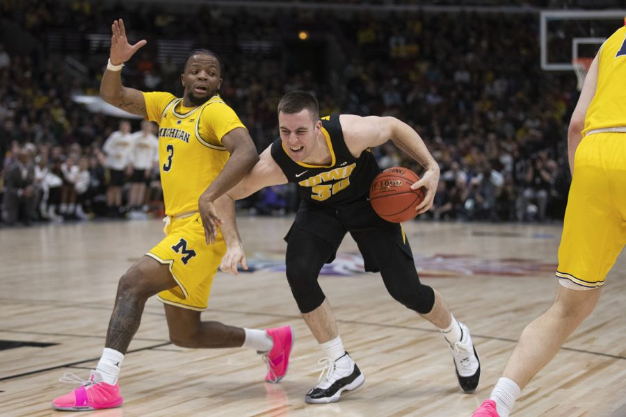 Iowa guard Connor McCaffery drives to the basket during the Iowa/Michigan Big Ten Tournament mens basketball game in the United Center in Chicago on Friday, March 15, 2019. The Wolverines lead the Hawkeyes, 40-27, at the half.