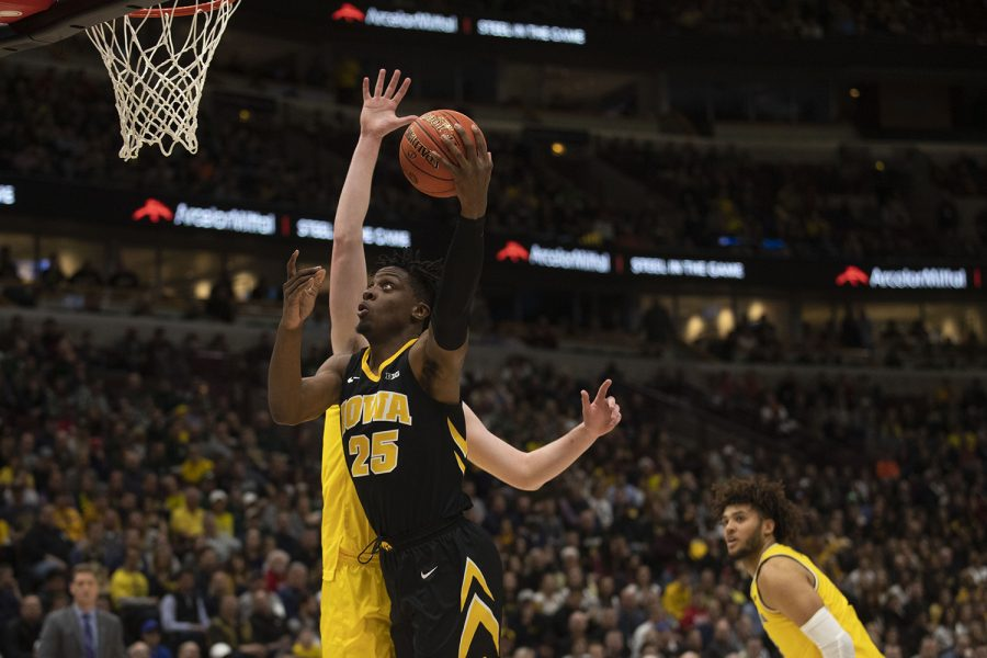 Iowa forward Tyler Cook attempts a layup during the Iowa/Michigan Big Ten Tournament mens basketball game in the United Center in Chicago on Friday, March 15, 2019. The Wolverines lead the Hawkeyes, 40-27, at the half.