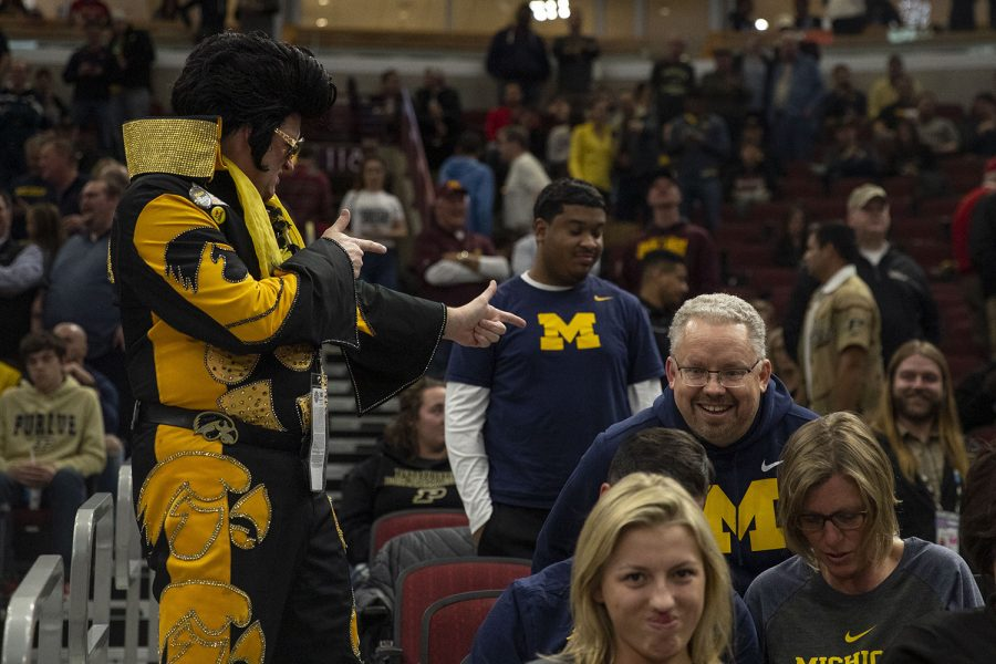 Hawkeye Elvis gestures toward a Michigan fan during the Iowa/Michigan Big Ten Tournament men's basketball game in the United Center in Chicago on Friday, March 15, 2019. The Wolverines defeated the Hawkeyes, 74-53.