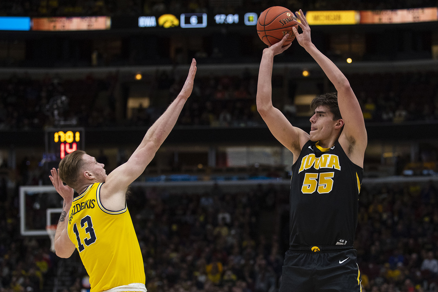 Iowa forward Luka Garza attempts a shot during the Iowa/Michigan Big Ten Tournament men's basketball game in the United Center in Chicago on Friday, March 15, 2019. The Wolverines defeated the Hawkeyes, 74-53.