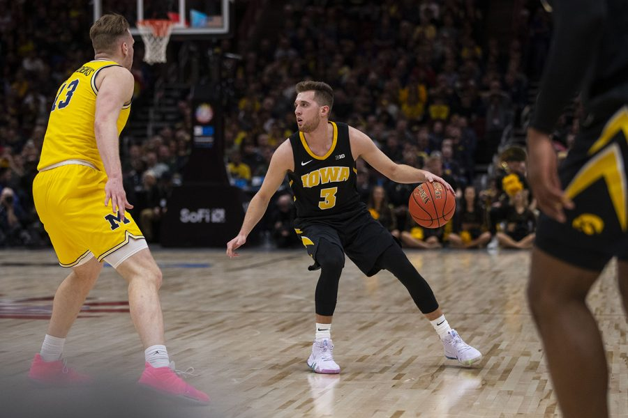 Iowa guard Jordan Bohannon looks to pass the ball during the Iowa/Michigan Big Ten Tournament mens basketball game in the United Center in Chicago on Friday, March 15, 2019. The Wolverines defeated the Hawkeyes, 74-53. (Lily Smith/The Daily Iowan)