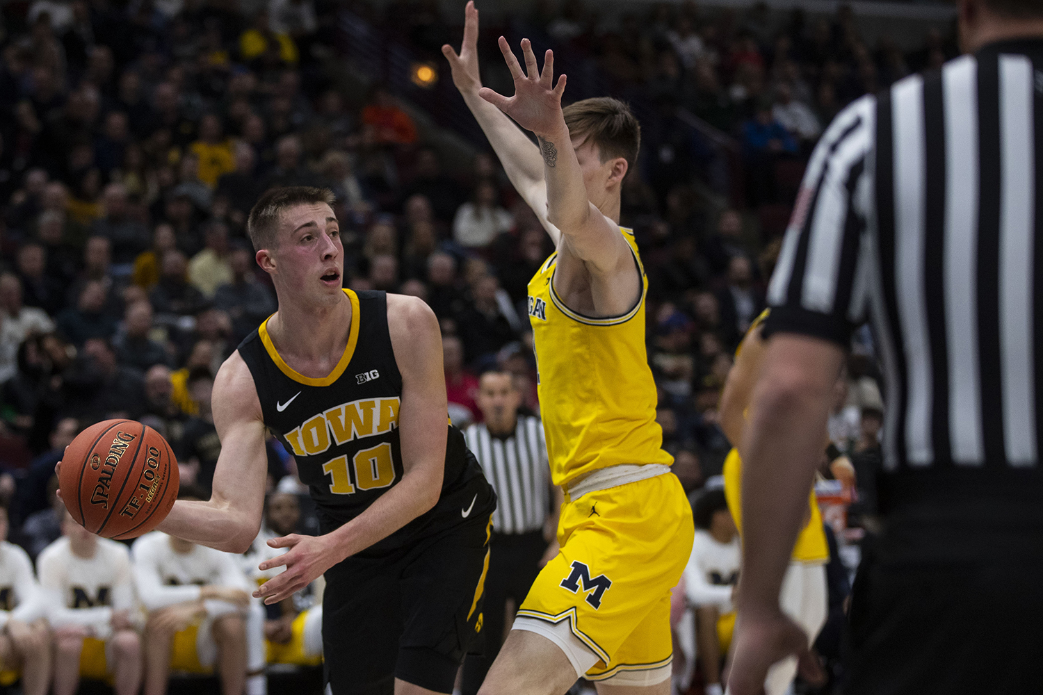 Iowa+guard+Joe+Wieskamp+looks+to+pass+the+ball+during+the+Iowa%2FMichigan+Big+Ten+Tournament+men%27s+basketball+game+in+the+United+Center+in+Chicago+on+Friday%2C+March+15%2C+2019.+The+Wolverines+defeated+the+Hawkeyes%2C+74-53.+