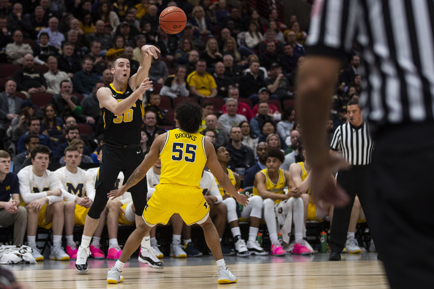 Iowa+guard+Connor+McCaffery+passes+the+ball+over+Michigan+guard+Eli+Brooks+during+the+Iowa%2FMichigan+Big+Ten+Tournament+men%27s+basketball+game+in+the+United+Center+in+Chicago+on+Friday%2C+March+15%2C+2019.+The+Wolverines+defeated+the+Hawkeyes%2C+74-53.+