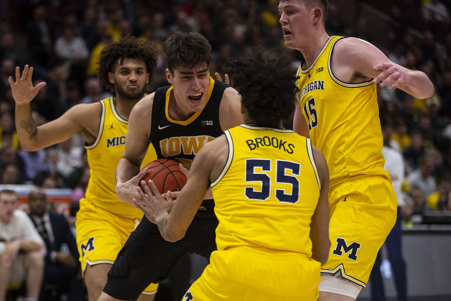 Iowa+forward+Luka+Garza+gets+tangled+in+Michigan+defense+during+the+Iowa%2FMichigan+Big+Ten+Tournament+men%27s+basketball+game+in+the+United+Center+in+Chicago+on+Friday%2C+March+15%2C+2019.+The+Wolverines+defeated+the+Hawkeyes%2C+74-53.+
