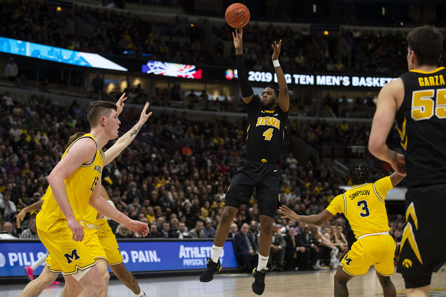 Iowa+guard+Isaiah+Moss+attempts+a+shot+during+the+Iowa%2FMichigan+Big+Ten+Tournament+men%27s+basketball+game+in+the+United+Center+in+Chicago+on+Friday%2C+March+15%2C+2019.+The+Wolverines+defeated+the+Hawkeyes%2C+74-53.+