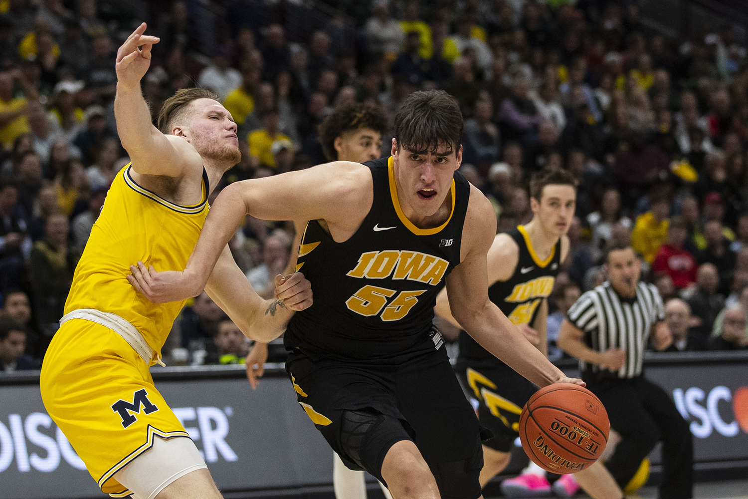 Iowa forward Luka Garza drives to the basket during the Iowa/Michigan Big Ten Tournament men's basketball game in the United Center in Chicago on Friday, March 15, 2019. The Wolverines defeated the Hawkeyes, 74-53.