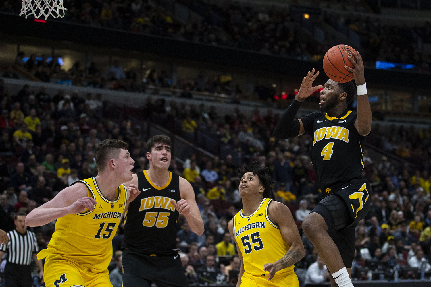 Iowa+guard+Isaiah+Moss+attempts+a+shot+during+the+Iowa%2FMichigan+Big+Ten+Tournament+men%27s+basketball+game+in+the+United+Center+in+Chicago+on+Friday%2C+March+15%2C+2019.+The+Wolverines+defeated+the+Hawkeyes%2C+74-53.