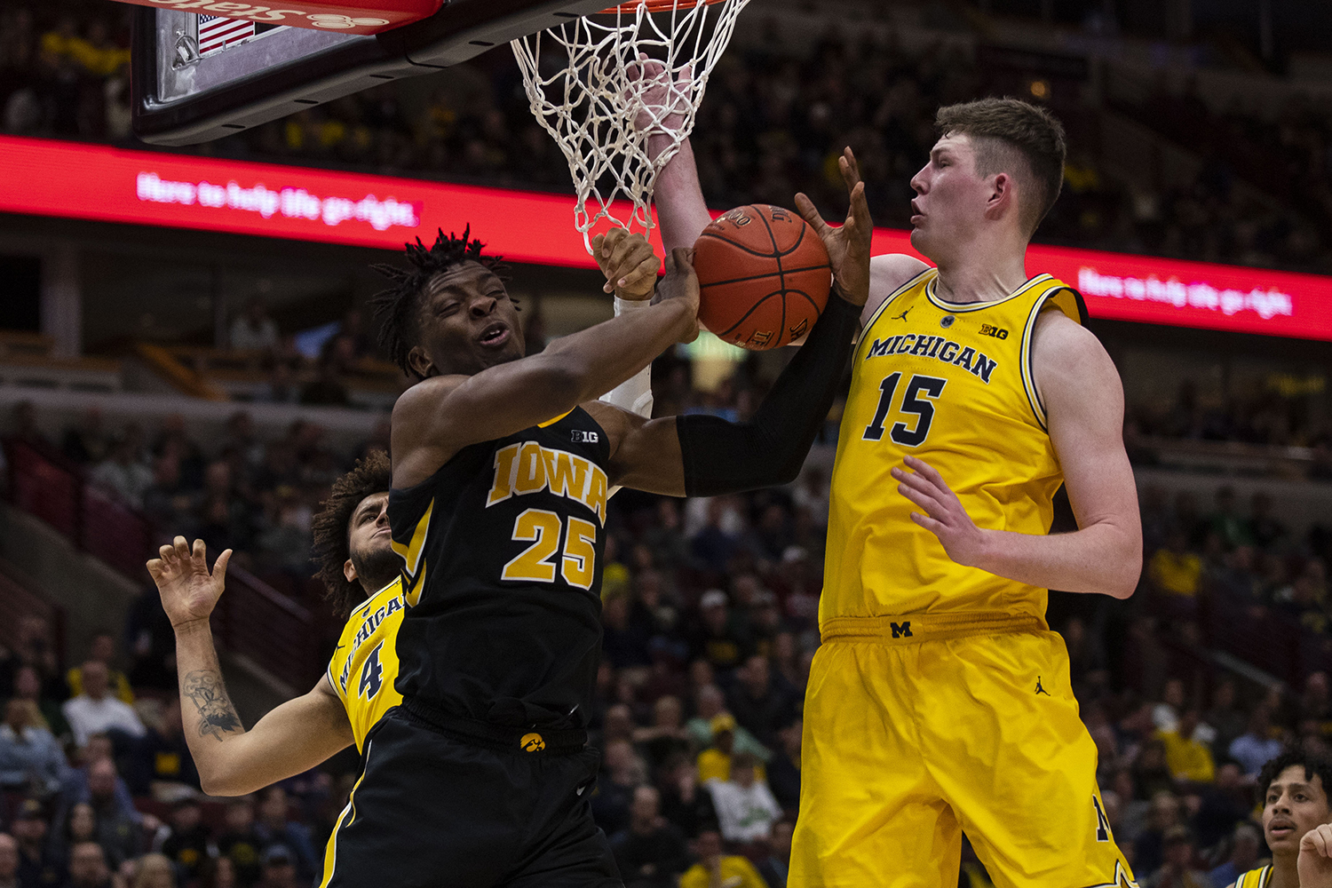 Iowa forward Tyler Cook loses control of the ball during the Iowa/Michigan Big Ten Tournament men's basketball game in the United Center in Chicago on Friday, March 15, 2019. The Wolverines defeated the Hawkeyes, 74-53.