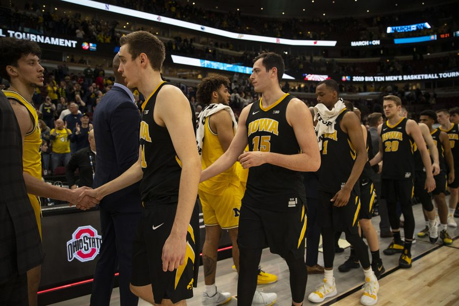 Iowa shakes hands with Michigan after the Iowa/Michigan Big Ten Tournament mens basketball game in the United Center in Chicago on Friday, March 15, 2019. The Wolverines defeated the Hawkeyes, 74-53.