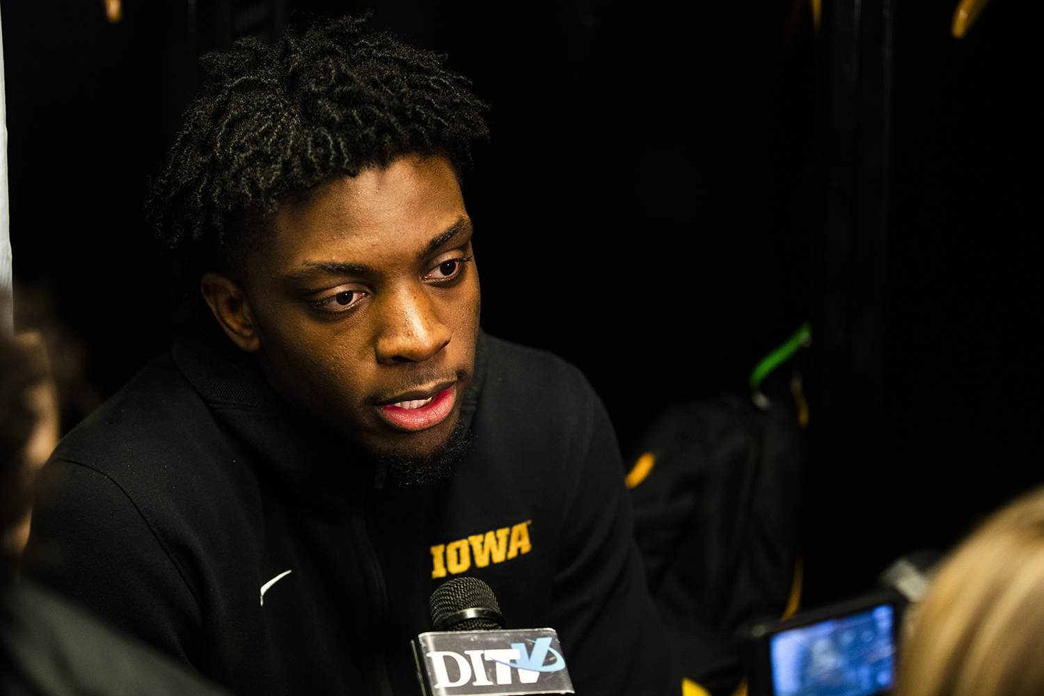 Iowa forward Tyler Cook answers questions during the Iowa press conference at Nationwide Arena in Columbus, Ohio on Thursday, March 21, 2019. The Hawkeyes will compete against the Cincinnati Bearcats tomorrow in the NCAA Tournament.
